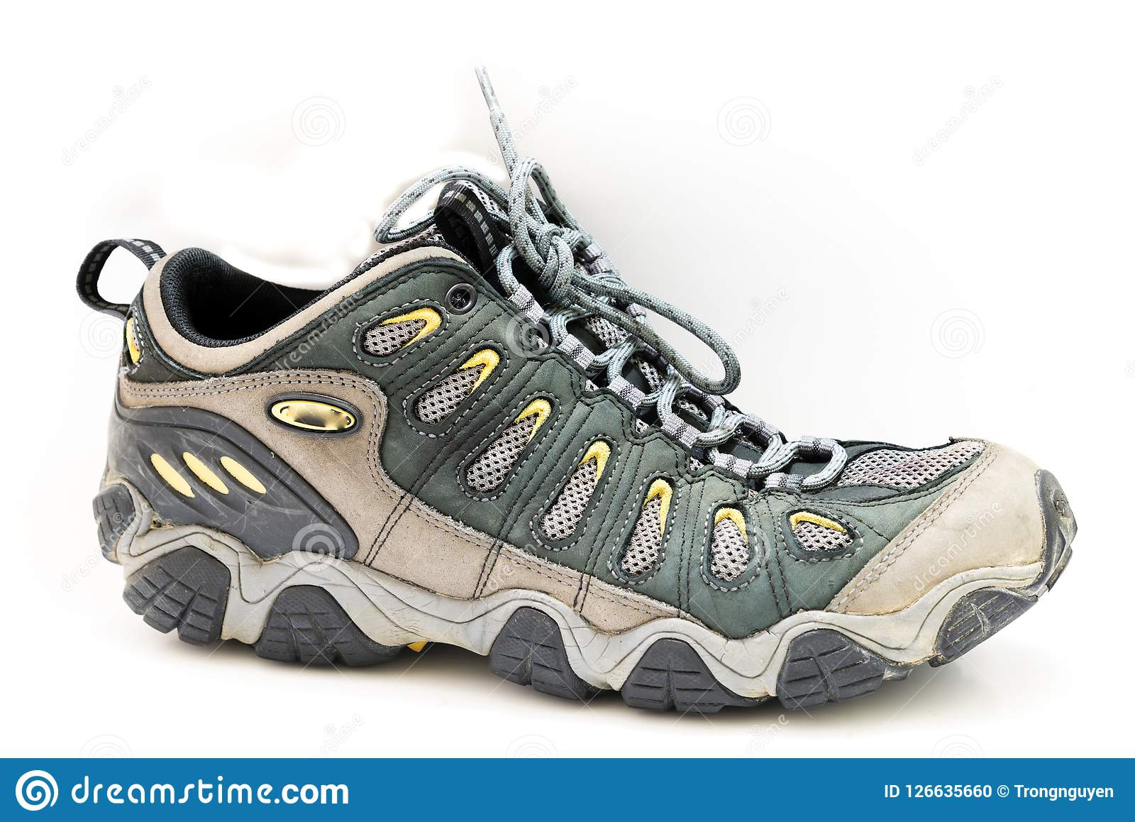 Close-up brand new male hiking shoes on white