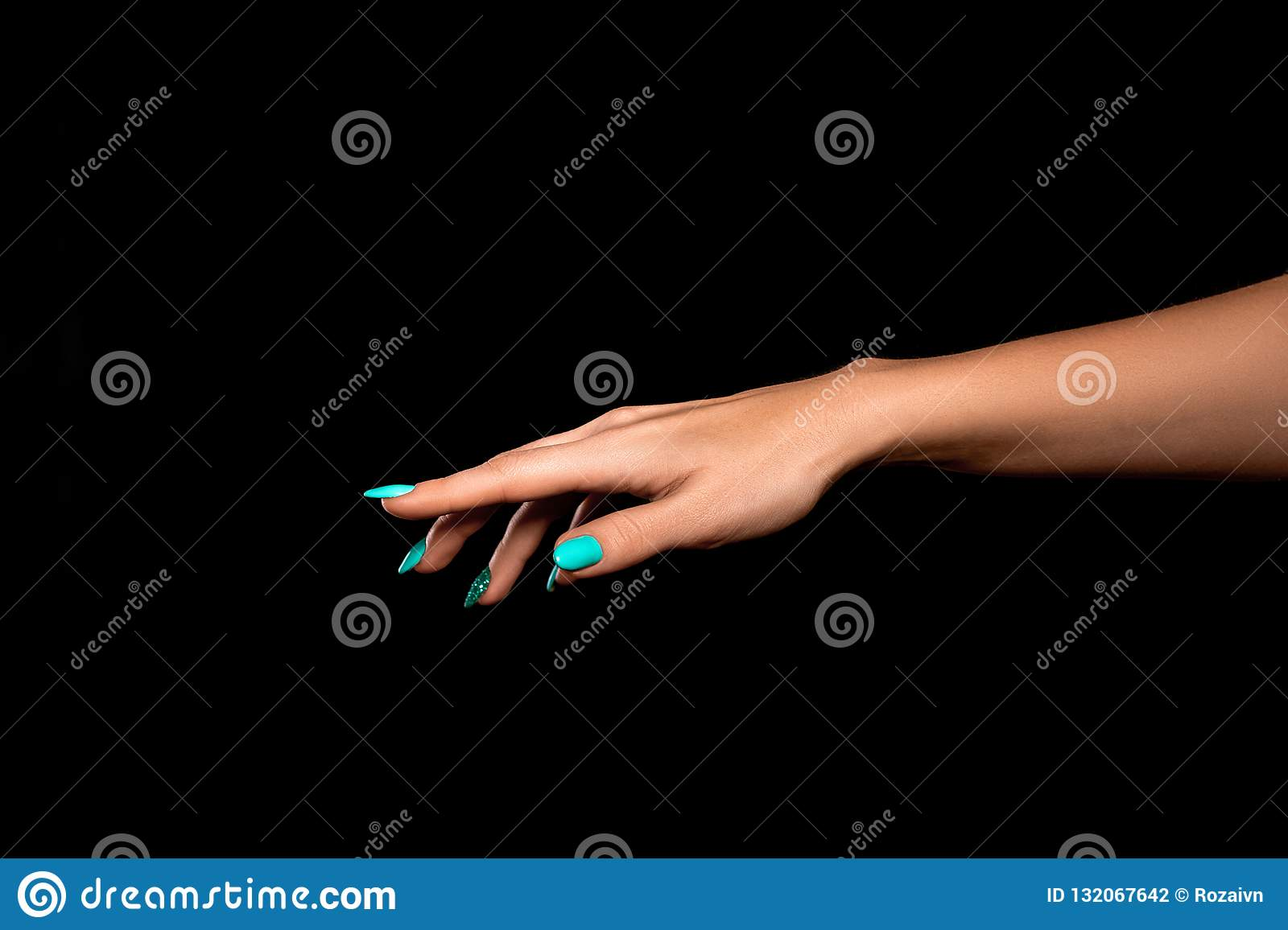 Studio shot of an unidentified woman`s hand showing a gesture of