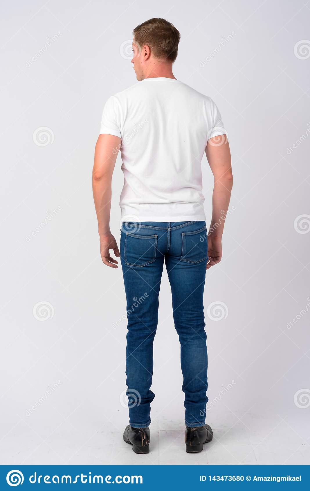 Full body shot rear view of young handsome man