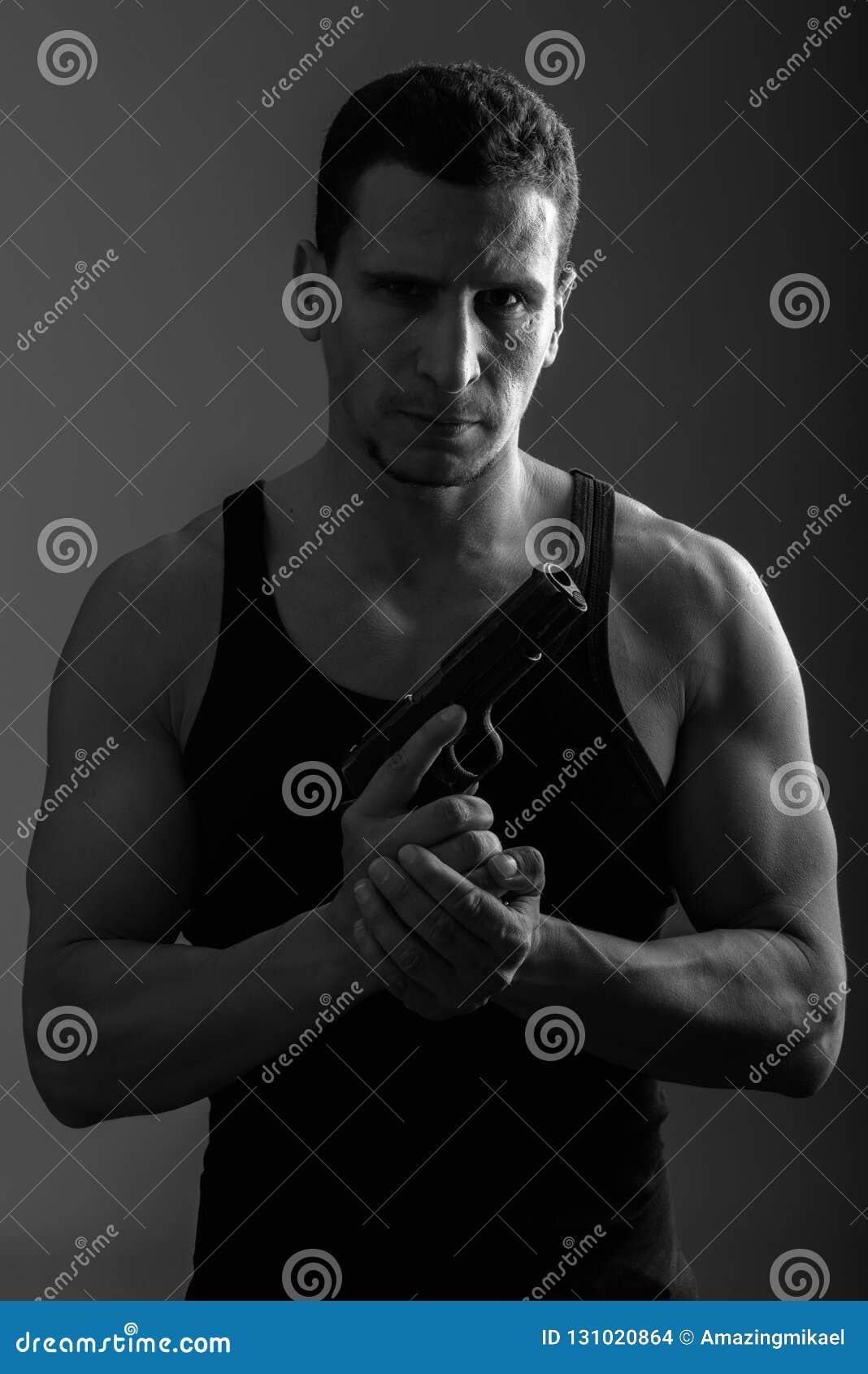 Muscular Man Gun Stock Images - Download 676 Royalty Free