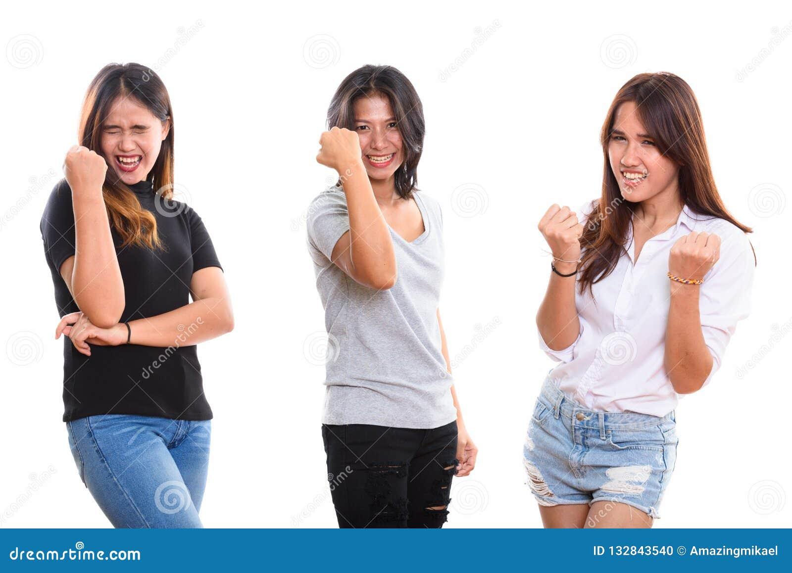 Studio strzelał trzy szczęśliwego młodego Azjatyckiego kobieta przyjaciela uśmiecha się whi