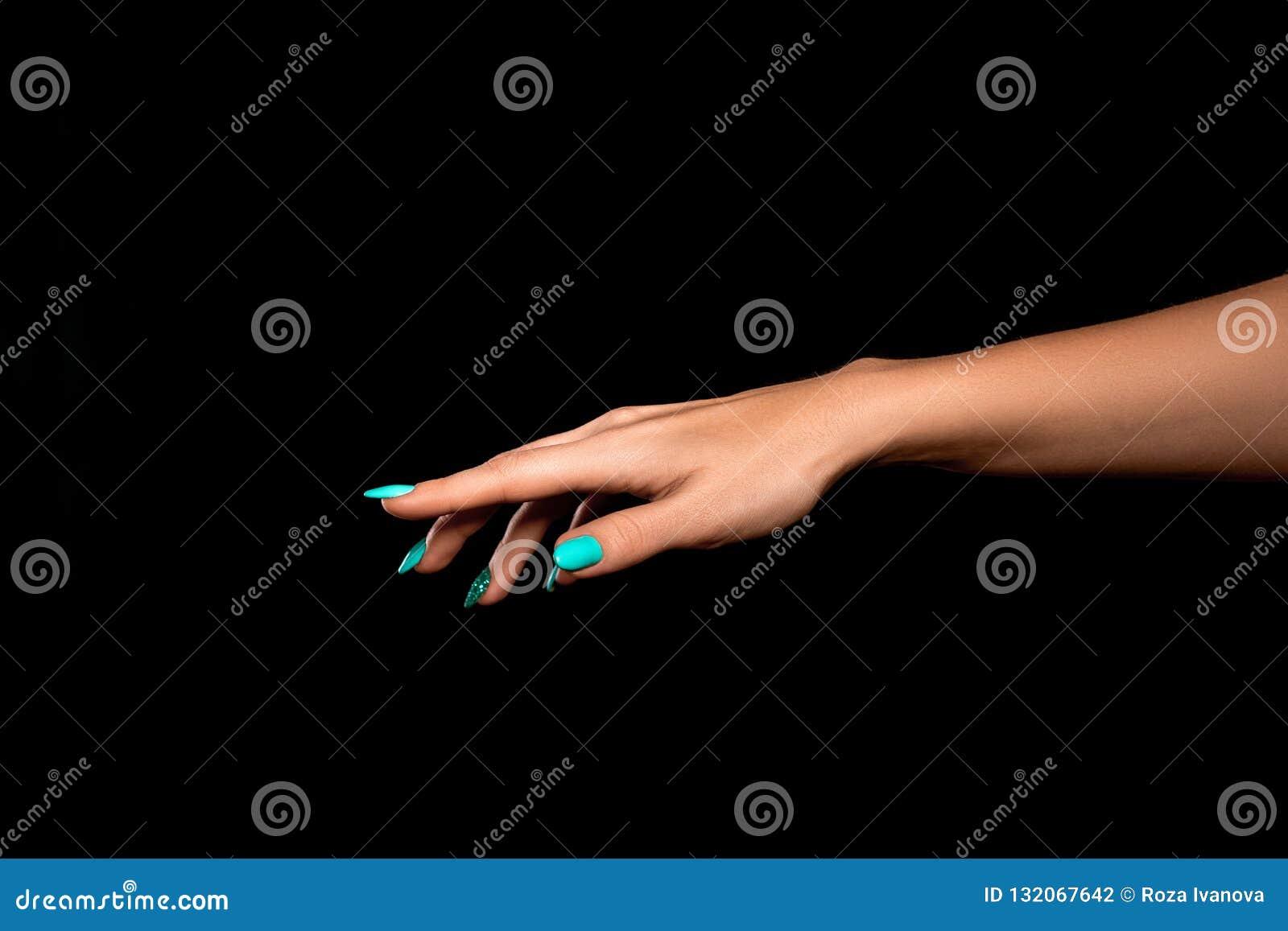 Studioskott av oidentifierade en kvinnas hand som visar en gest av
