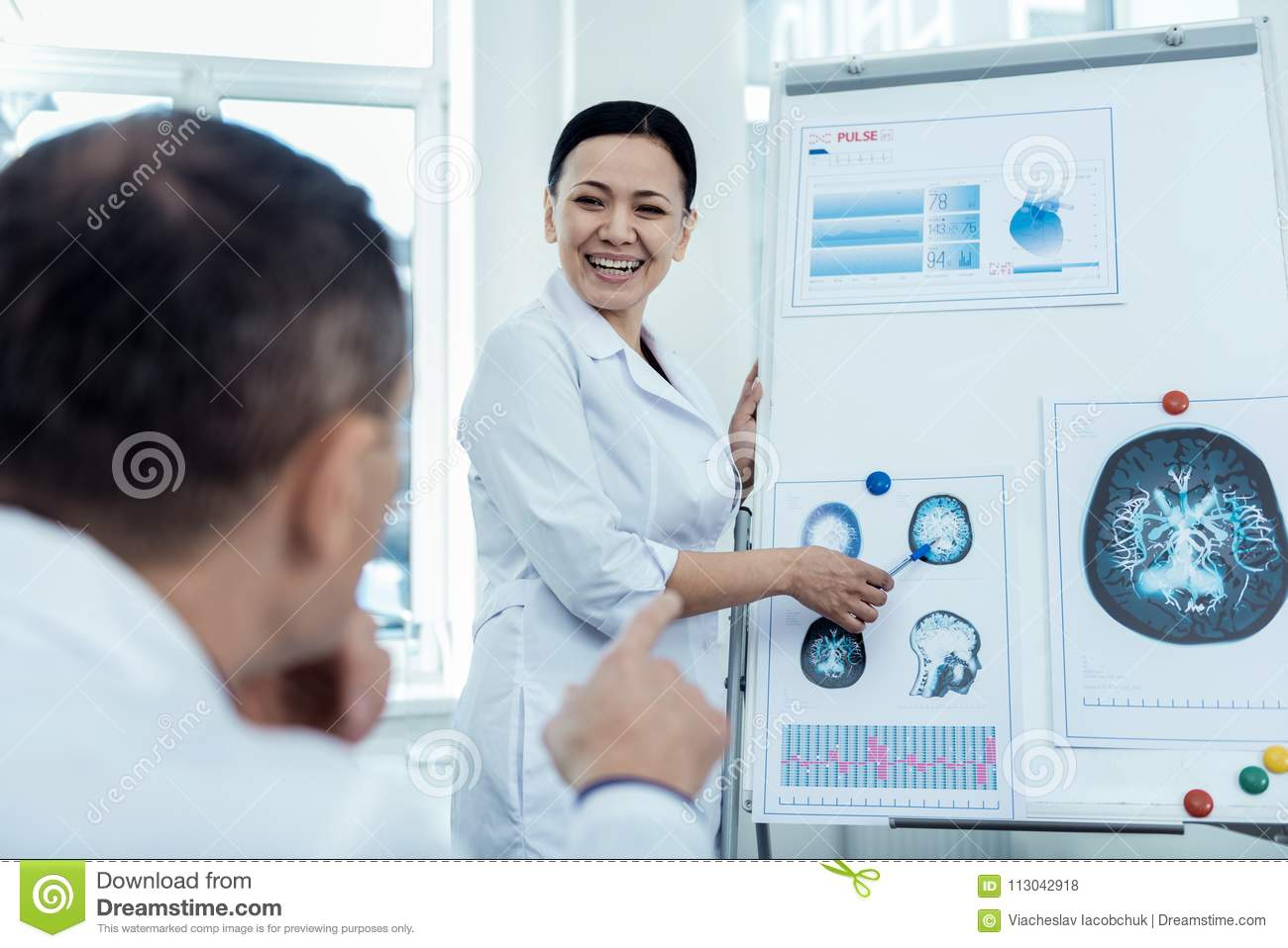 Positive Woman Presenting Her Neurology Research Stock Photo