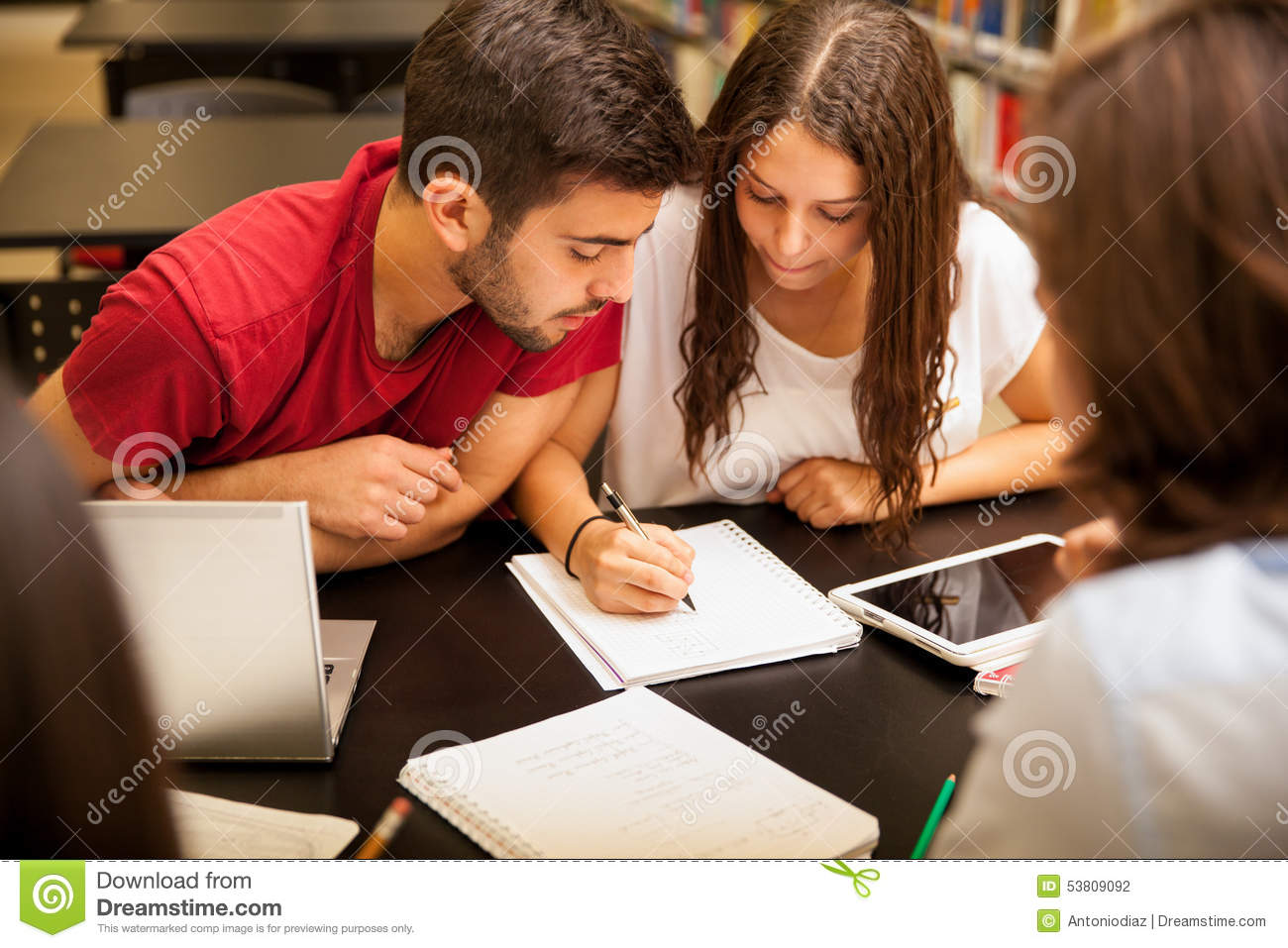 Study group stock photos royalty free pictures study group doing homework group of hispanic students doing homework together in the school library sciox Gallery