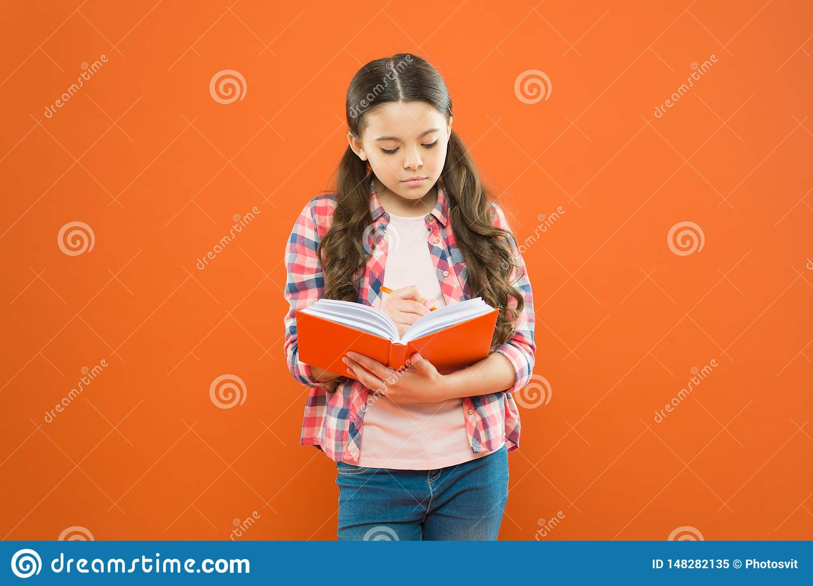 Study language. Girl cute write down idea notes. Notes to remember. Write essay or notes. Exercising writing workbook