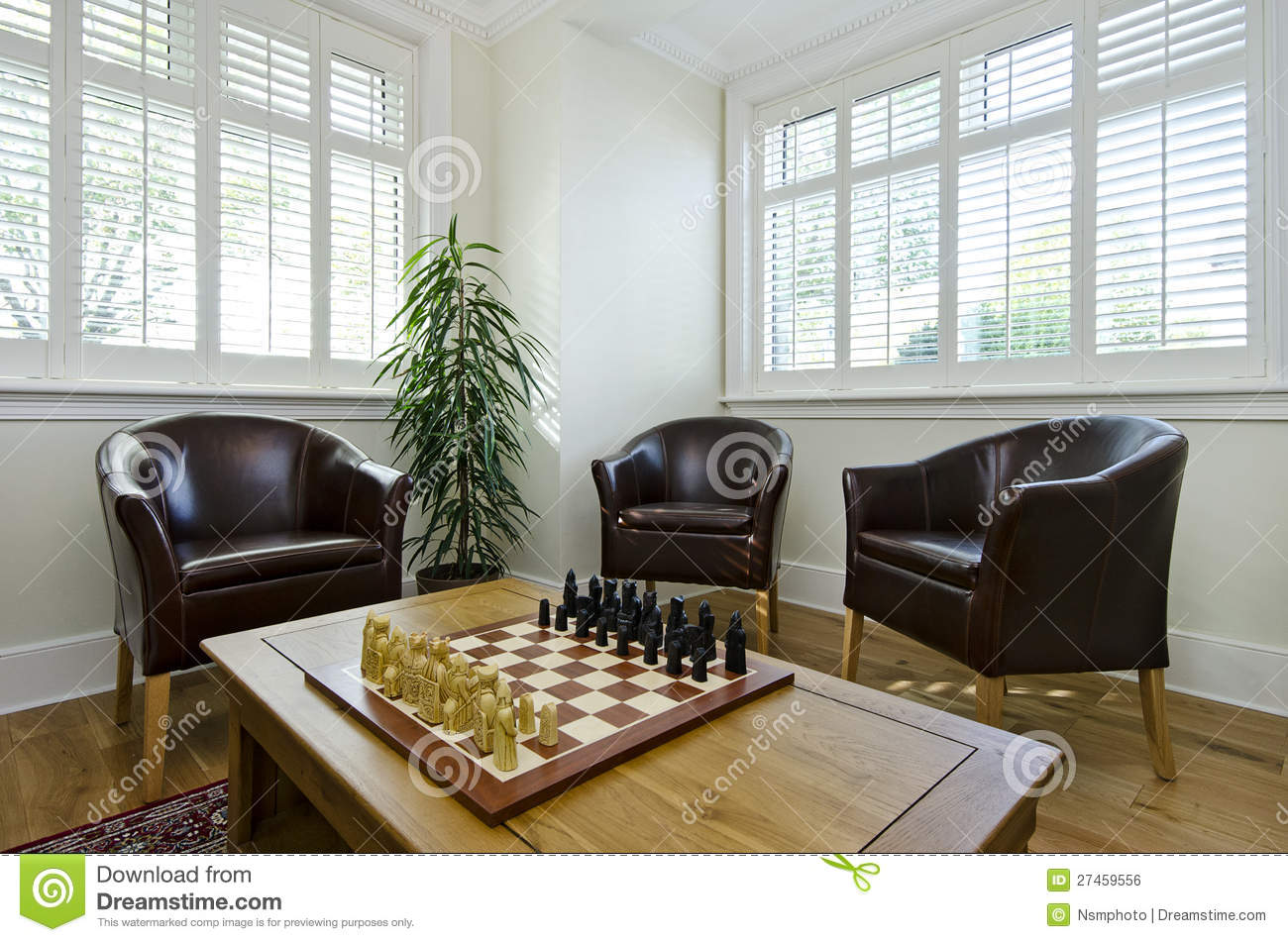 Study Room With Leather Armchairs And Chess Board Stock