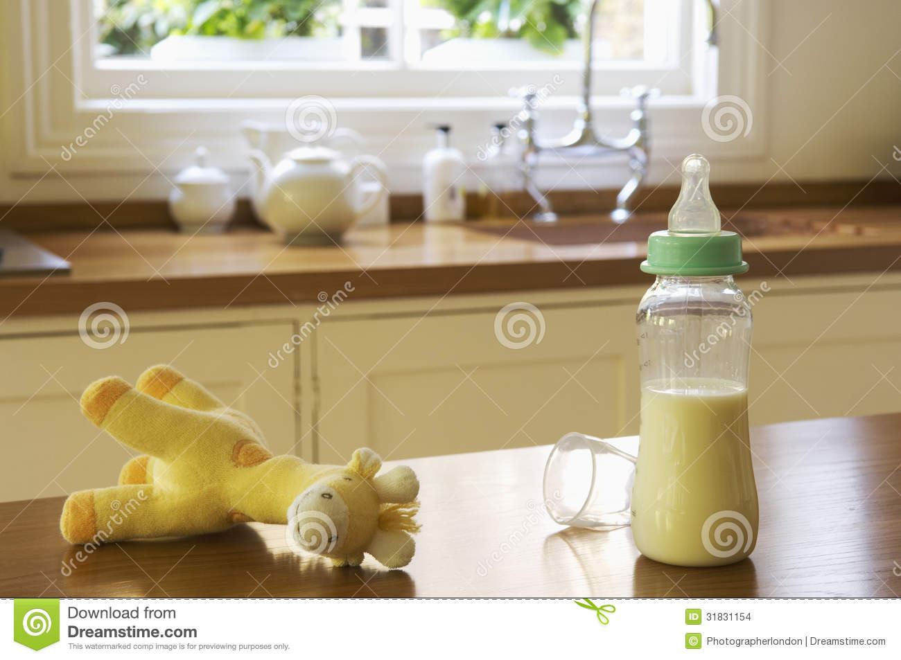 Kitchen Counter Close Up baby items with cellphone and keys on kitchen counter stock photos