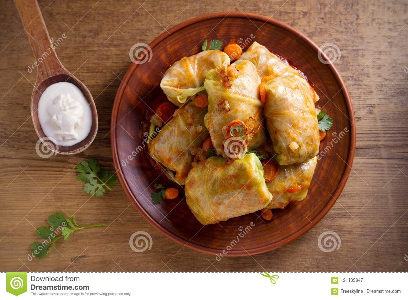Stuffed cabbage leaves with meat, rice and vegetables. Chou farci, dolma, sarma, sarmale, golubtsy or golabki - popular dish in ma