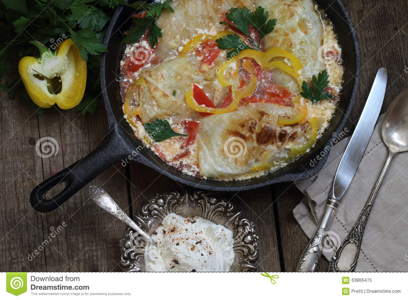 Stuffed cabbage stewed in sour cream with the sweet pepper, submitted ...