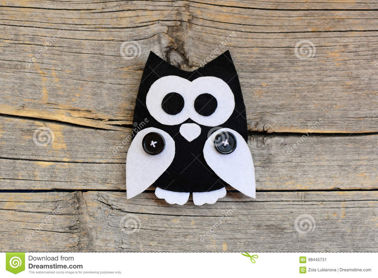 Stuffed Felt Owl Ornament On An Old Wooden Background With Empty