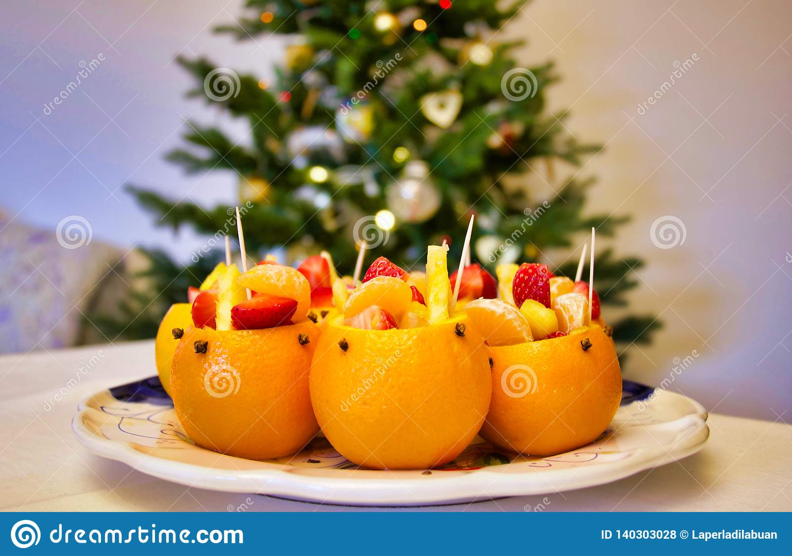 Stuffed Oranges With Fruit Salad On A Christmas Table Stock Photo