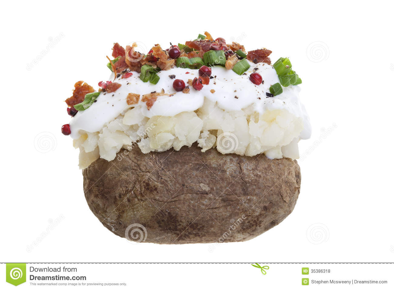 stuffed baked potato with sour cream, bacon bits, and Green onions ...