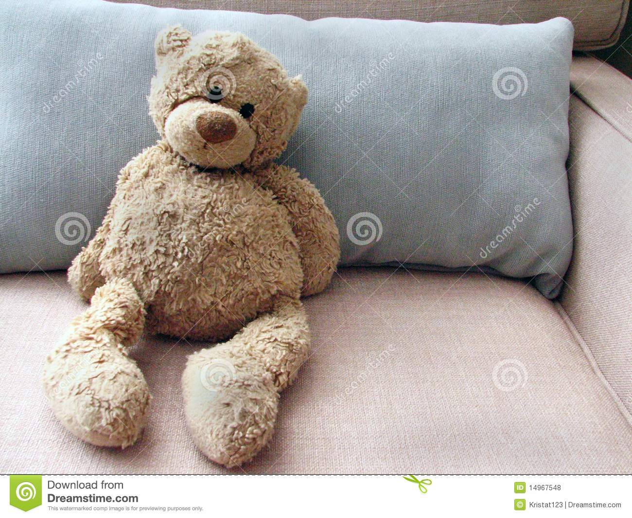 Stuffed Toy Teddy Bear On Couch With Pillow Stock Photo ...