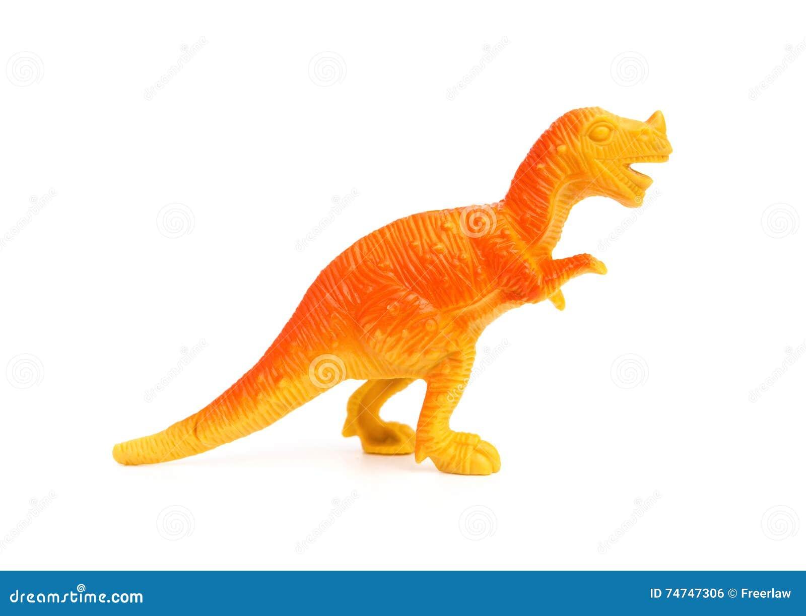 Stuk speelgoed van de zijaanzicht het oranje plastic dinosaurus op witte achtergrond