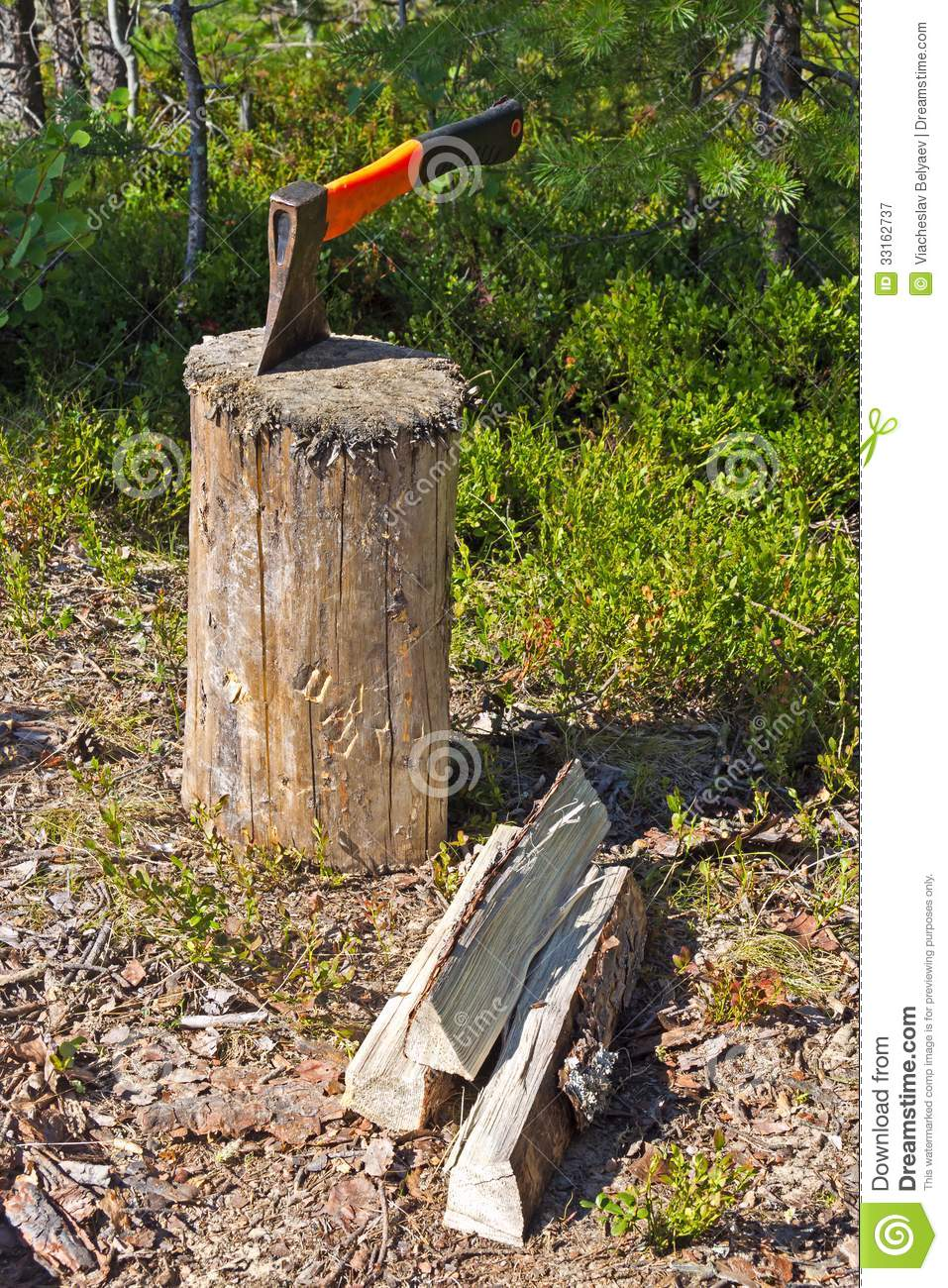 Stump axe and firewood royalty free stock photography