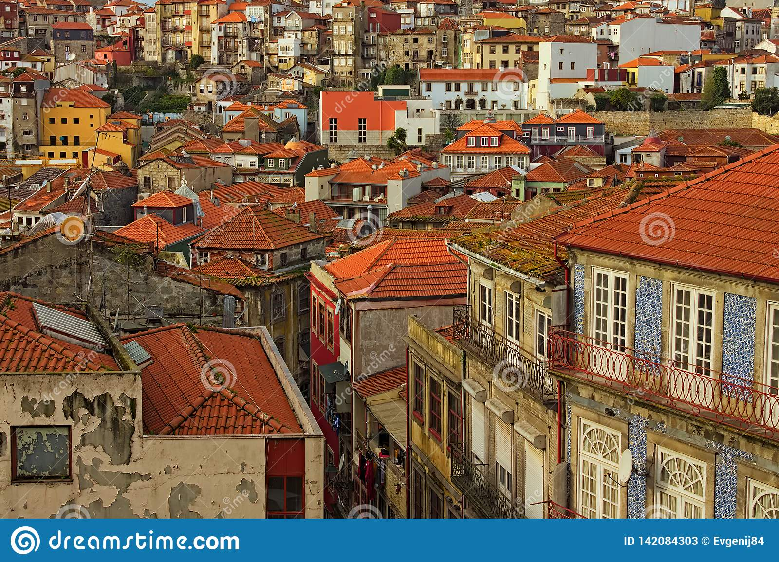 Stunning aerial view of traditional historic buildings in Porto. Vintage houses with red tile roofs.