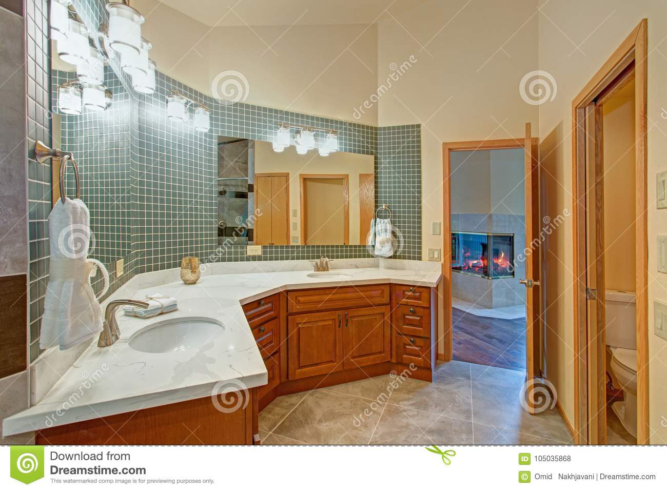 Stunning Bathroom With A Double Vanity With Marble Top