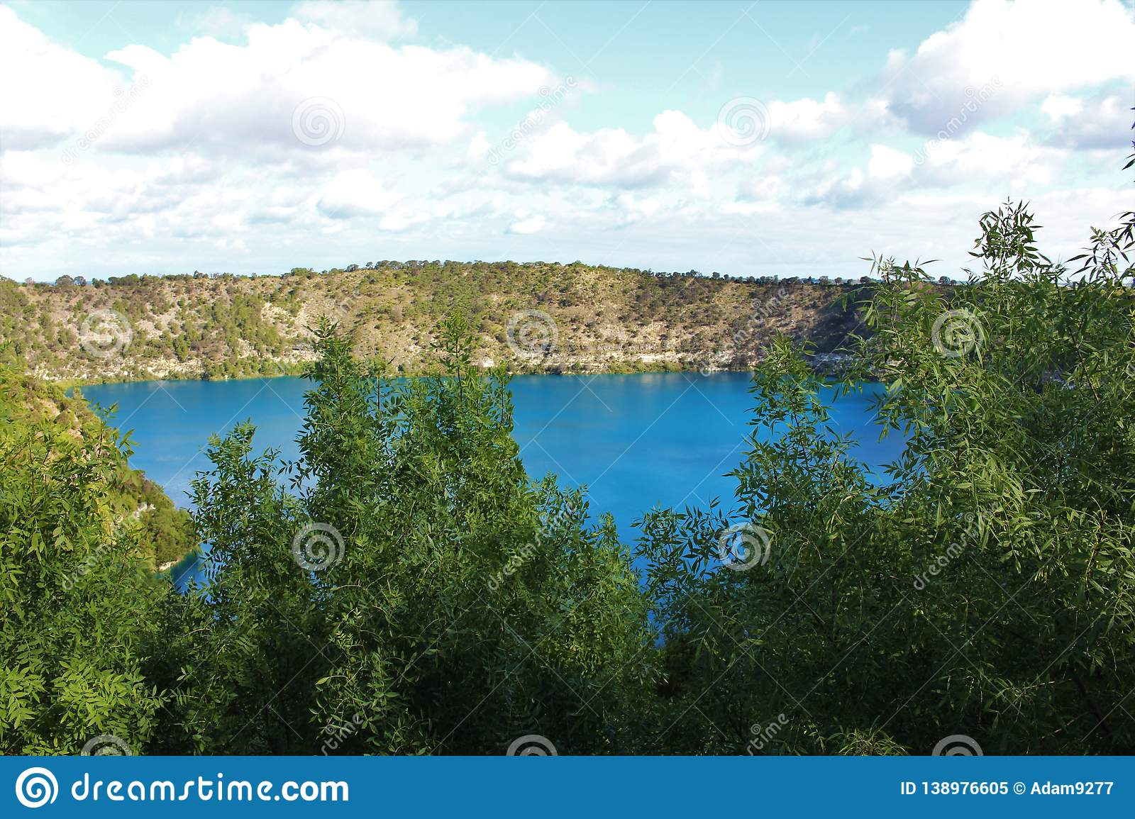 Stunning blue lake at Mount Gambier, Australia. Beautiful natural blue lake in a crater at Mount Gambier, Australia. Lake surrounded by cliffs with trees and royalty free stock photo