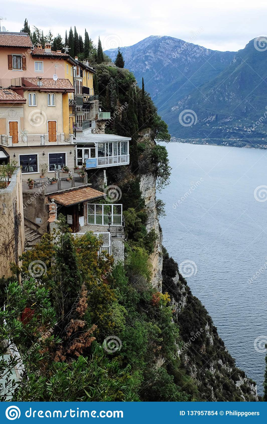Stunning houses on a rocky slope on Lake Garda in Italy