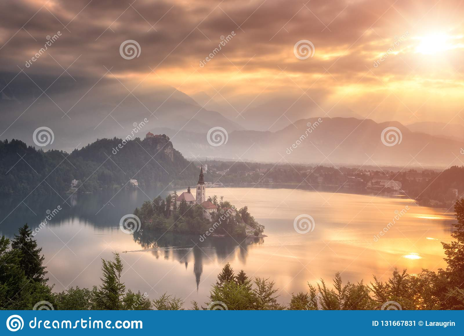 Golden sunrise over famous alpine lake Bled with Assumption of Mary pilgrimage church on the island, Slovenia