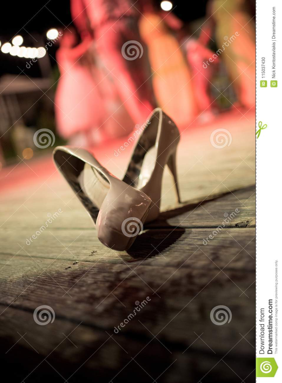 A Pair Of Bridal Shoes At The Outdoor Wedding Reception Stock Photo