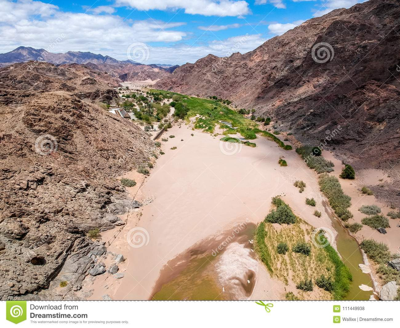 Stunning wide angle aerial drone view of the dry riverbed and mountains near Ai-Ais Hot Springs at the southern end of Fish River