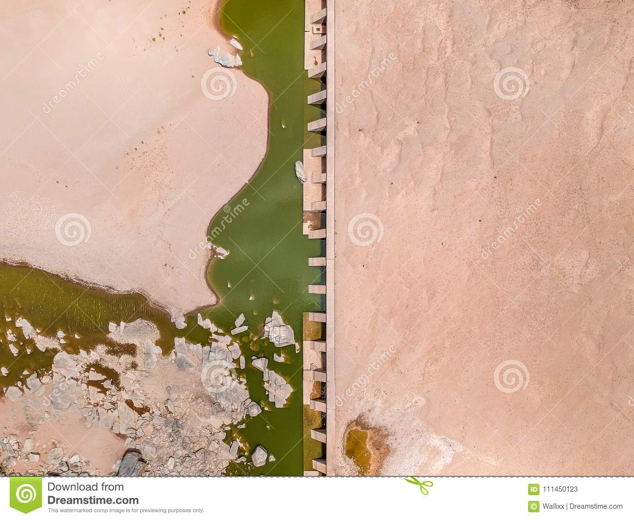 Stunning wide angle aerial drone view of the dry riverbed and an old dam with rests of water near Ai-Ais Hot Springs