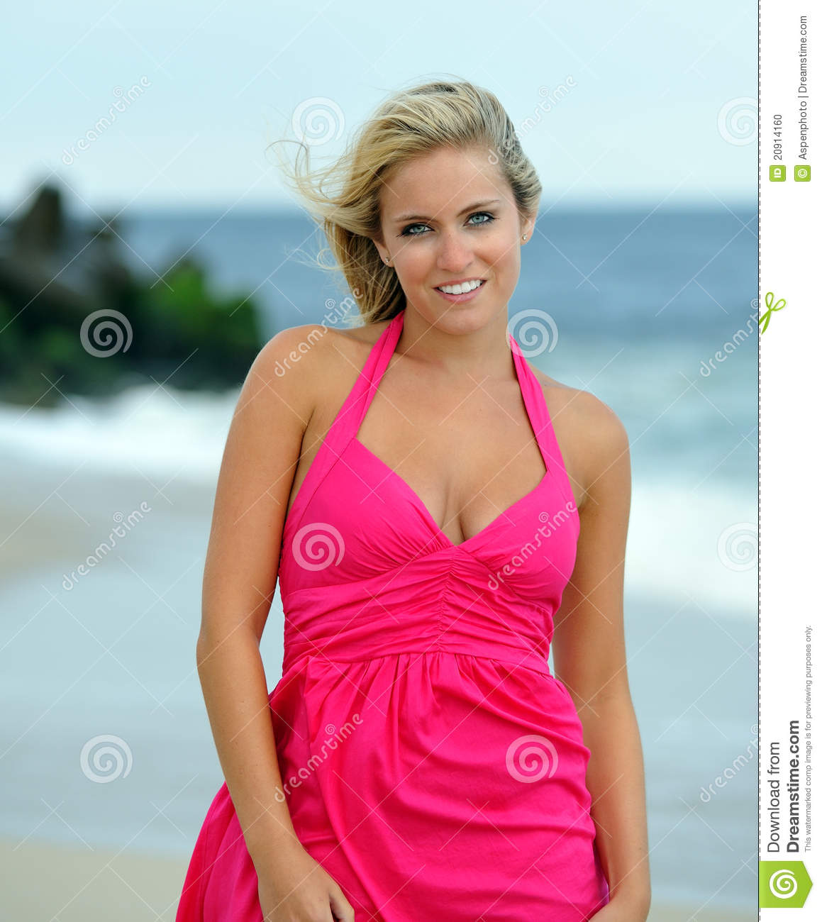 Stunning Young Blonde Woman Walking On The Beach Stock