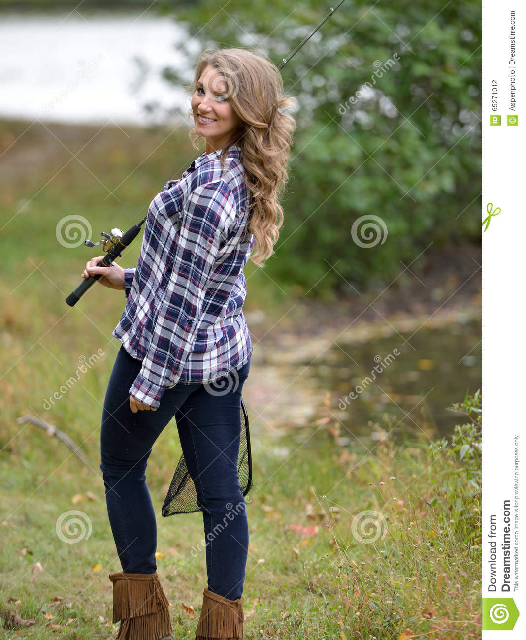 Stunning young woman fishing stock photo image 65271012 for Country girl flannel shirts
