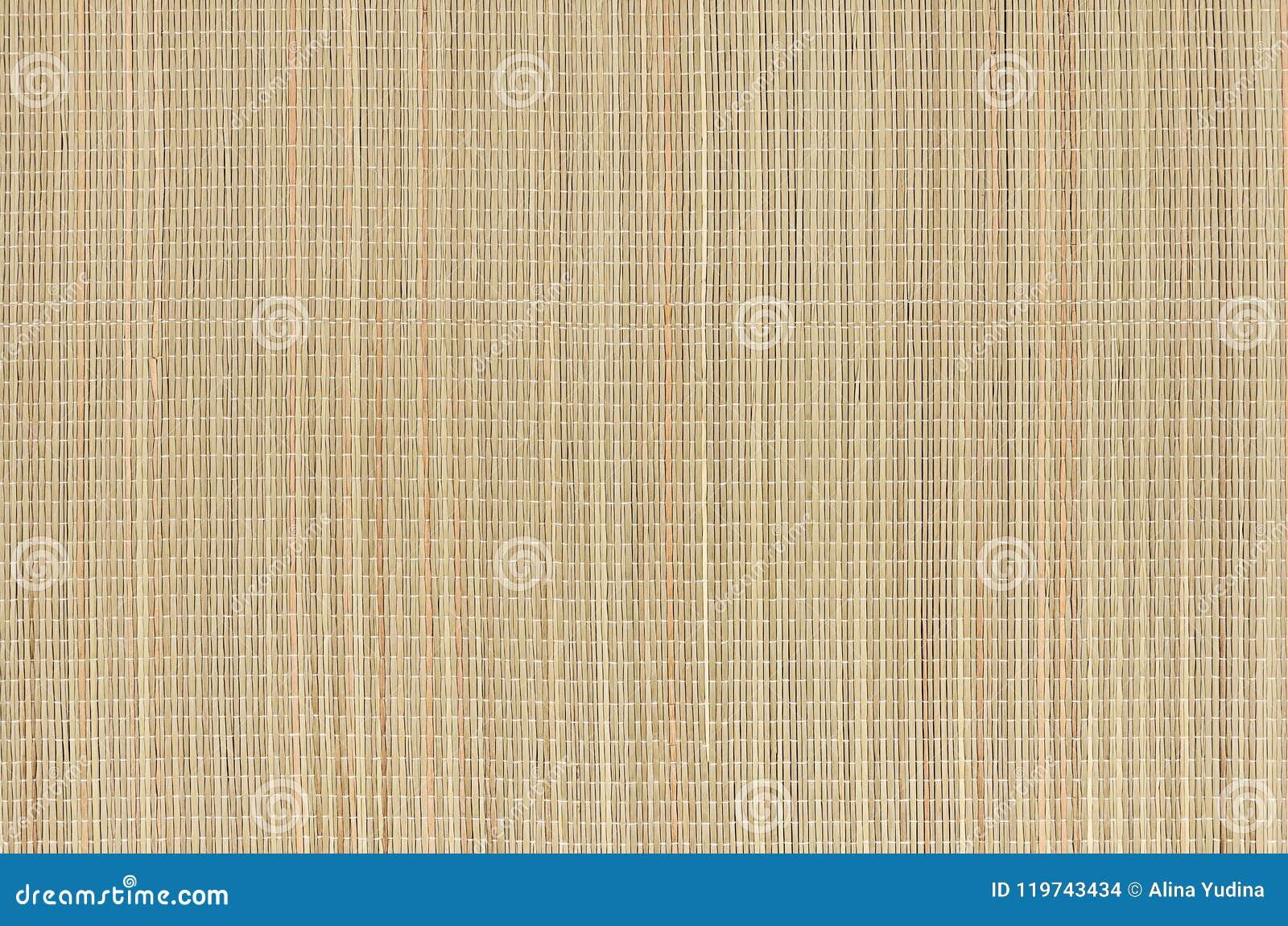 Stuoia naturale beige di erba di vimini asciutta come struttura, fondo