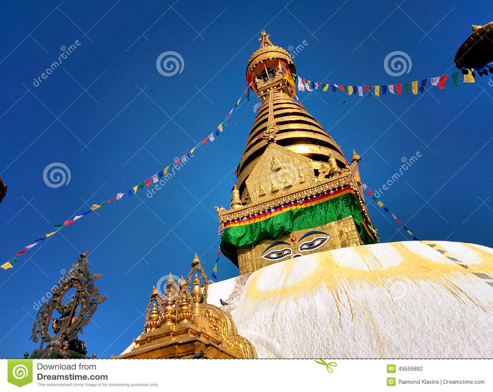 Stupa Swayambhunath with eyes and blue sky