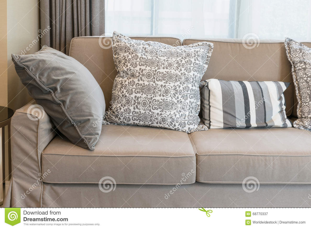 sturdy brown tweed sofa with grey patterned pillows royalty free stock image. Black Bedroom Furniture Sets. Home Design Ideas