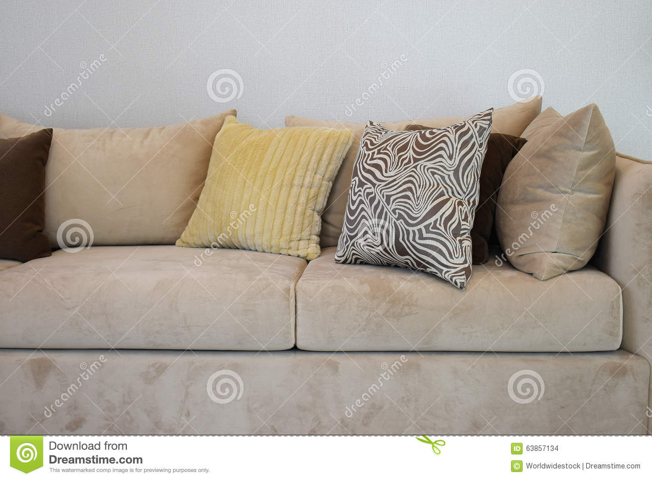 Sturdy Brown Tweed Sofa With Grey Patterned Pillows Stock Photo ...