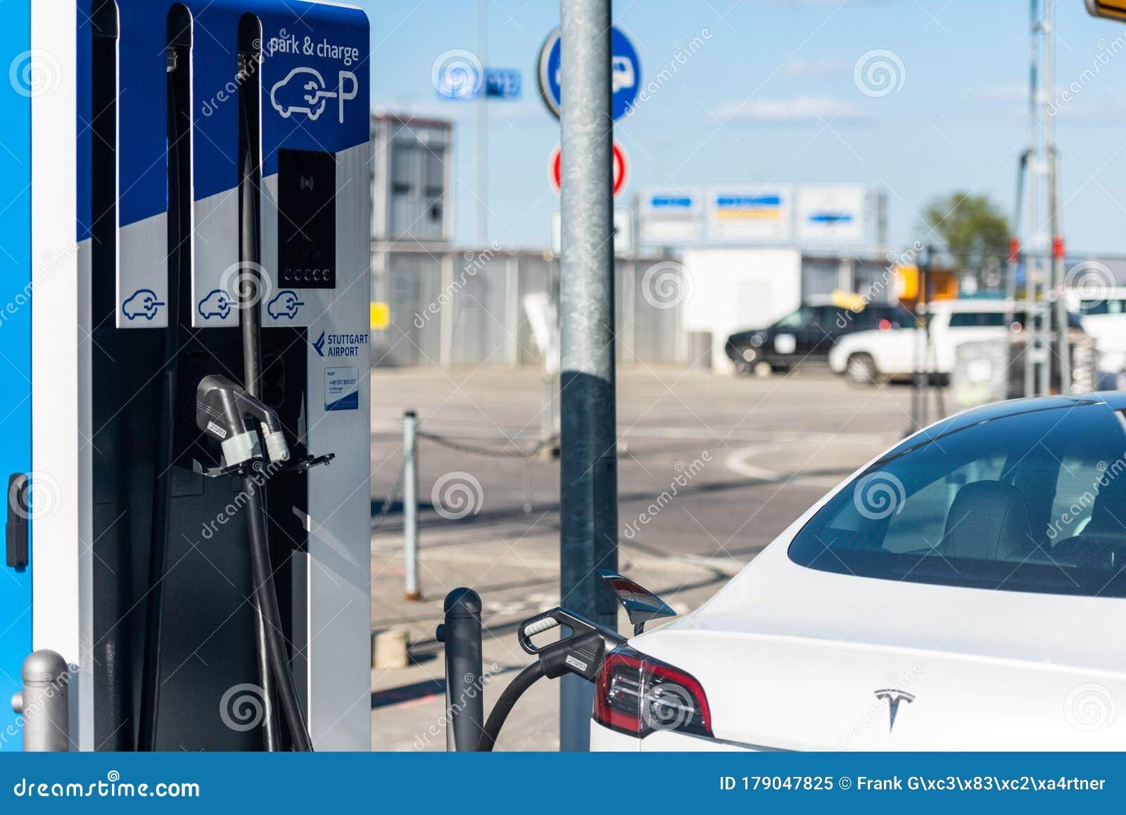 A Tesla Model 3 Electric Car Is Recharging The Batteries ...