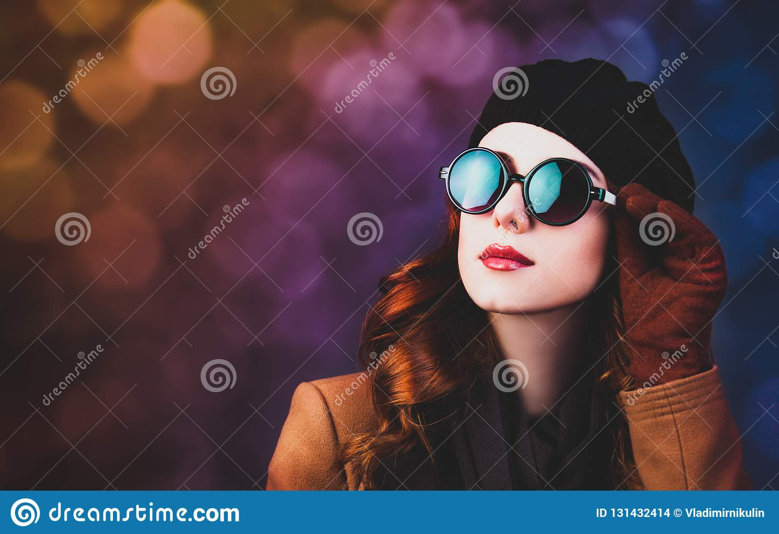 Style redhead woman in sunglasses and coat