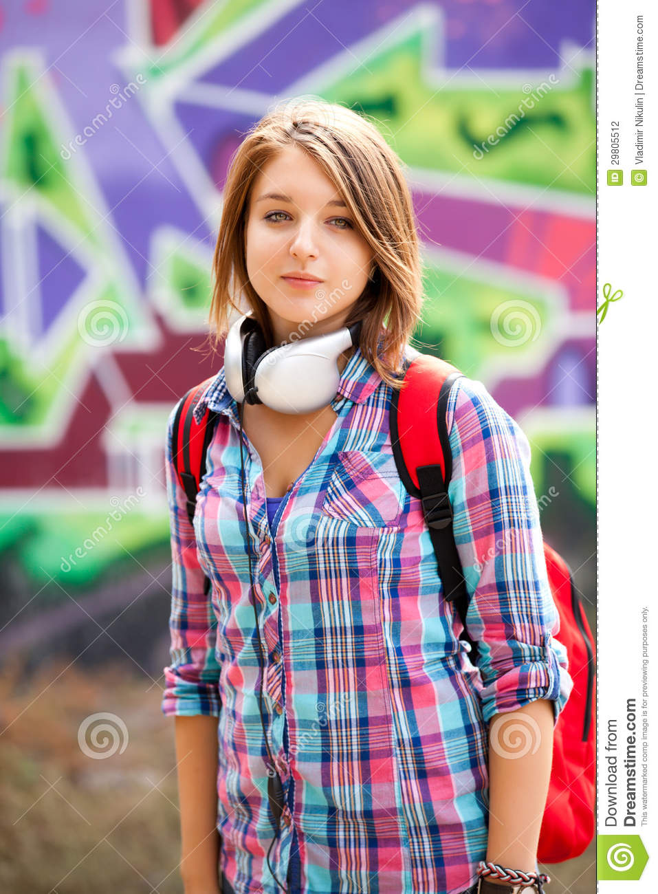 Style Teen Girl With Backpack Standing Near Graffiti Wall