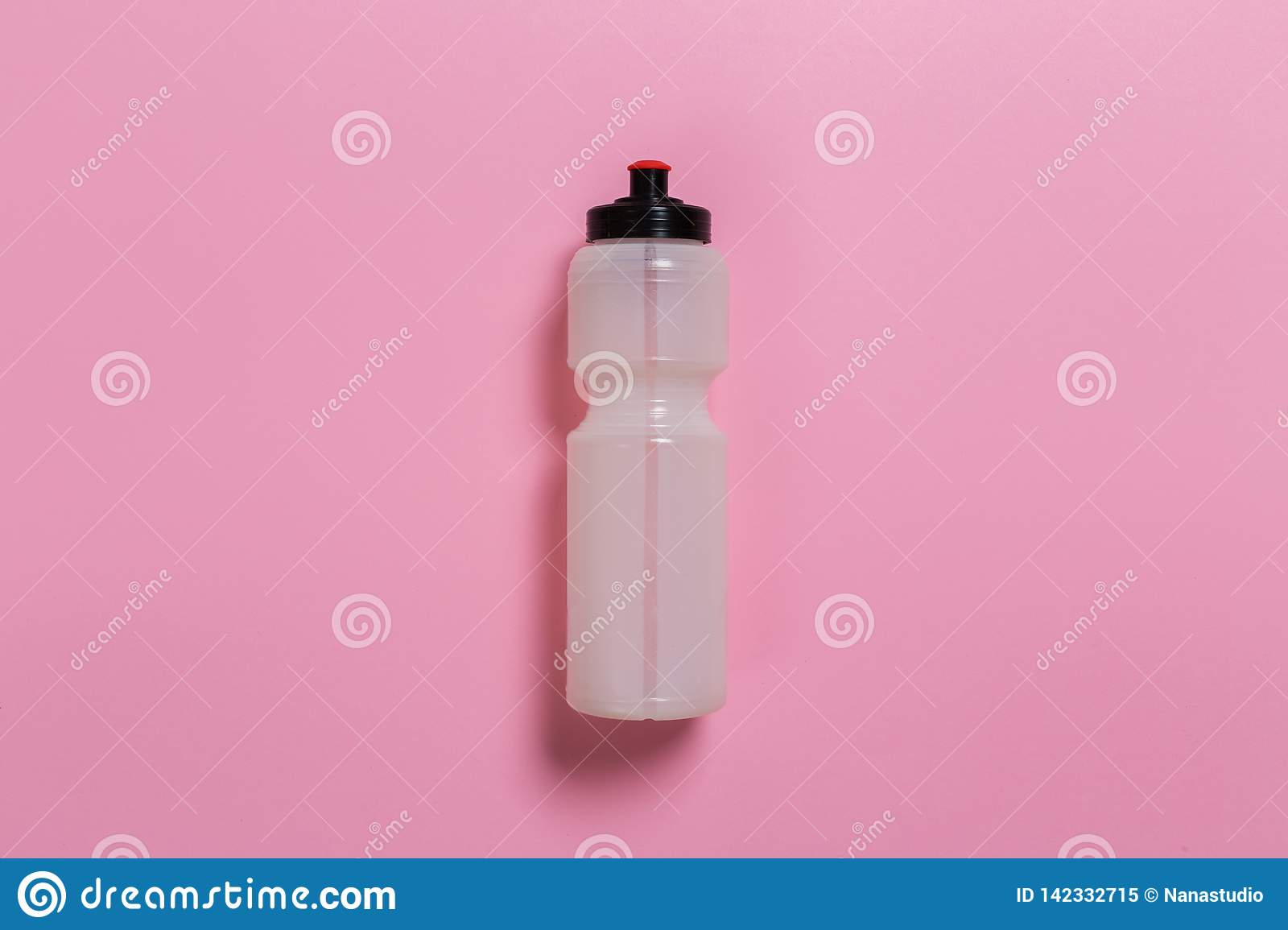 Styled photography of fitness equipment bottles on pink background