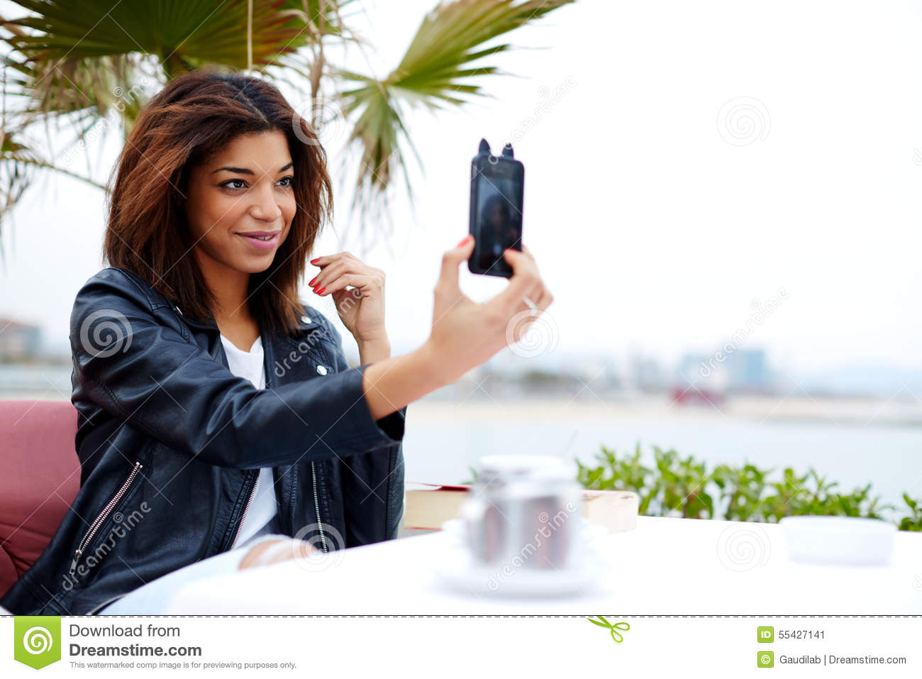 Stylish afro american woman taking self portrait with smartphone