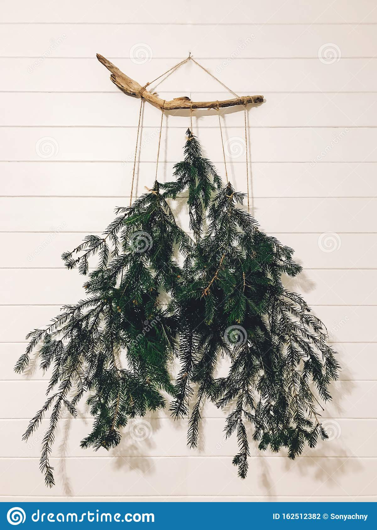 Stylish Alternative Christmas Tree On White Wall Modern Eco Christmas Tree Made Of Pine Branches Hanging On White Rural Wall In Stock Photo Image Of Card Abstract 162512382