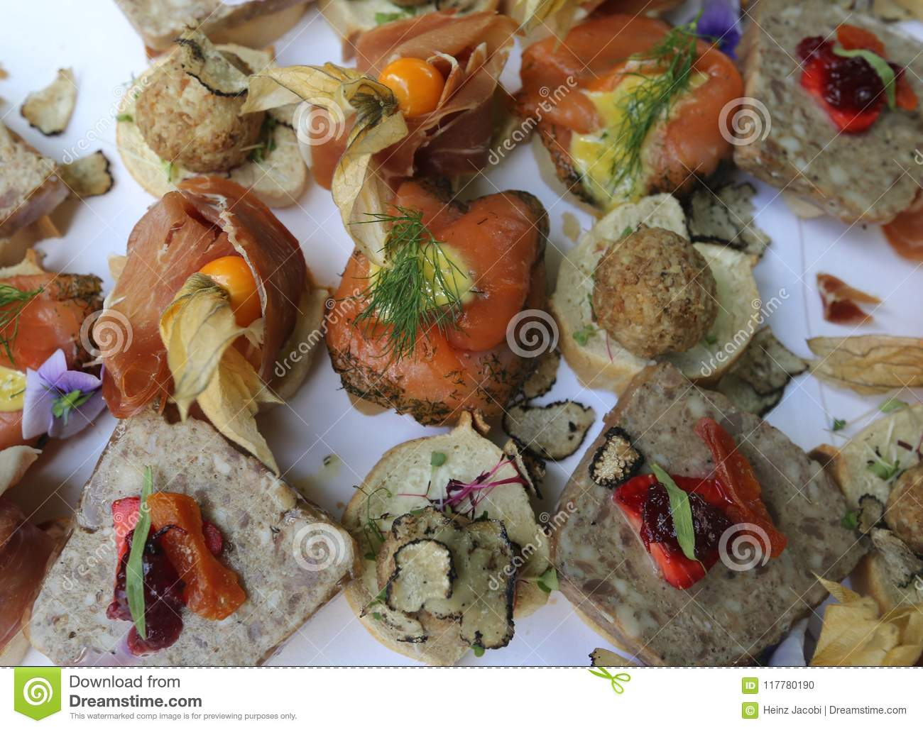 A stylish arrangement for the wedding guests with salmon, ham, pies and fruits