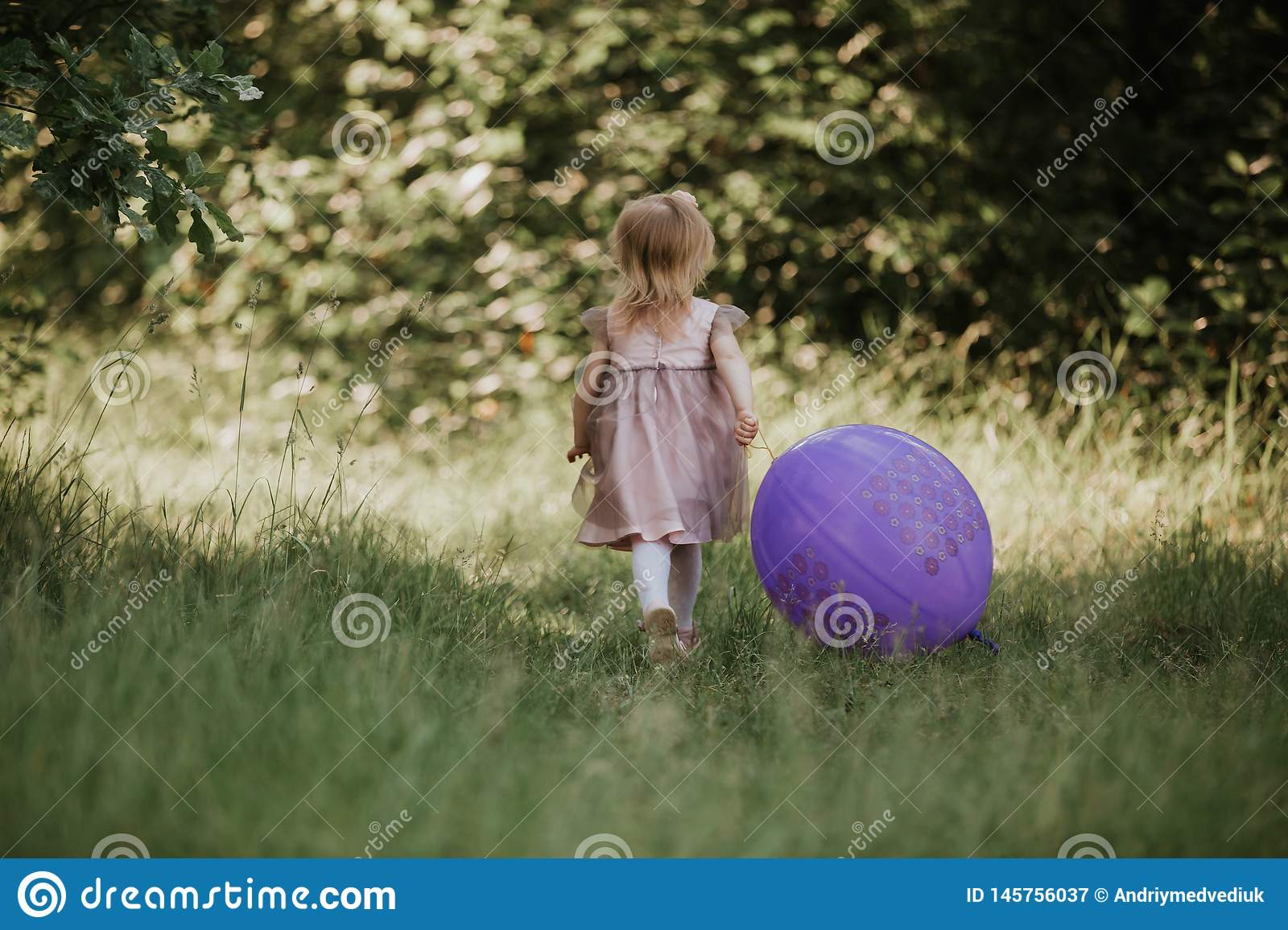 Stylish Baby Girl 2 5 Year Old Holding Big Balloon Wearing Trendy Pink Dress In Meadow Playful Birthday Party Little With A The Park