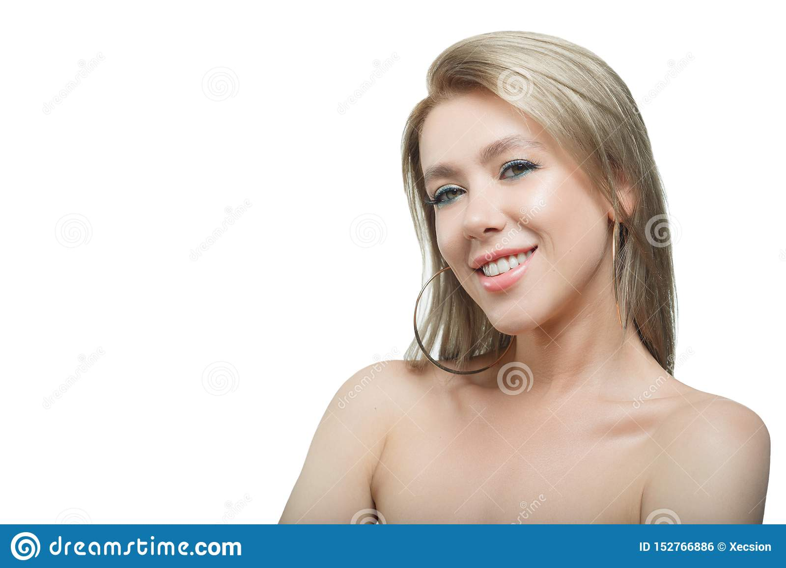Stylish beautiful girl with flowing hair looking at camera with joyful happy facial expression