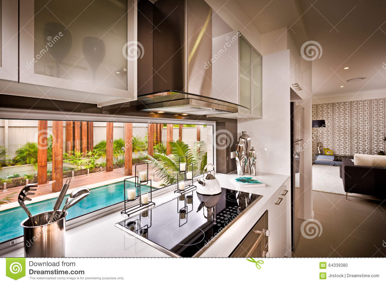 A Stylish Beautiful Kitchen With Living Room Attached Stock Photo
