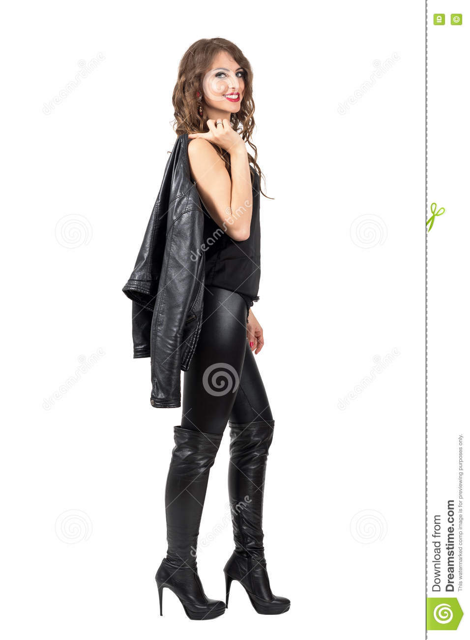 Stylish Beautiful Woman In Leather Boots And Pants Carrying