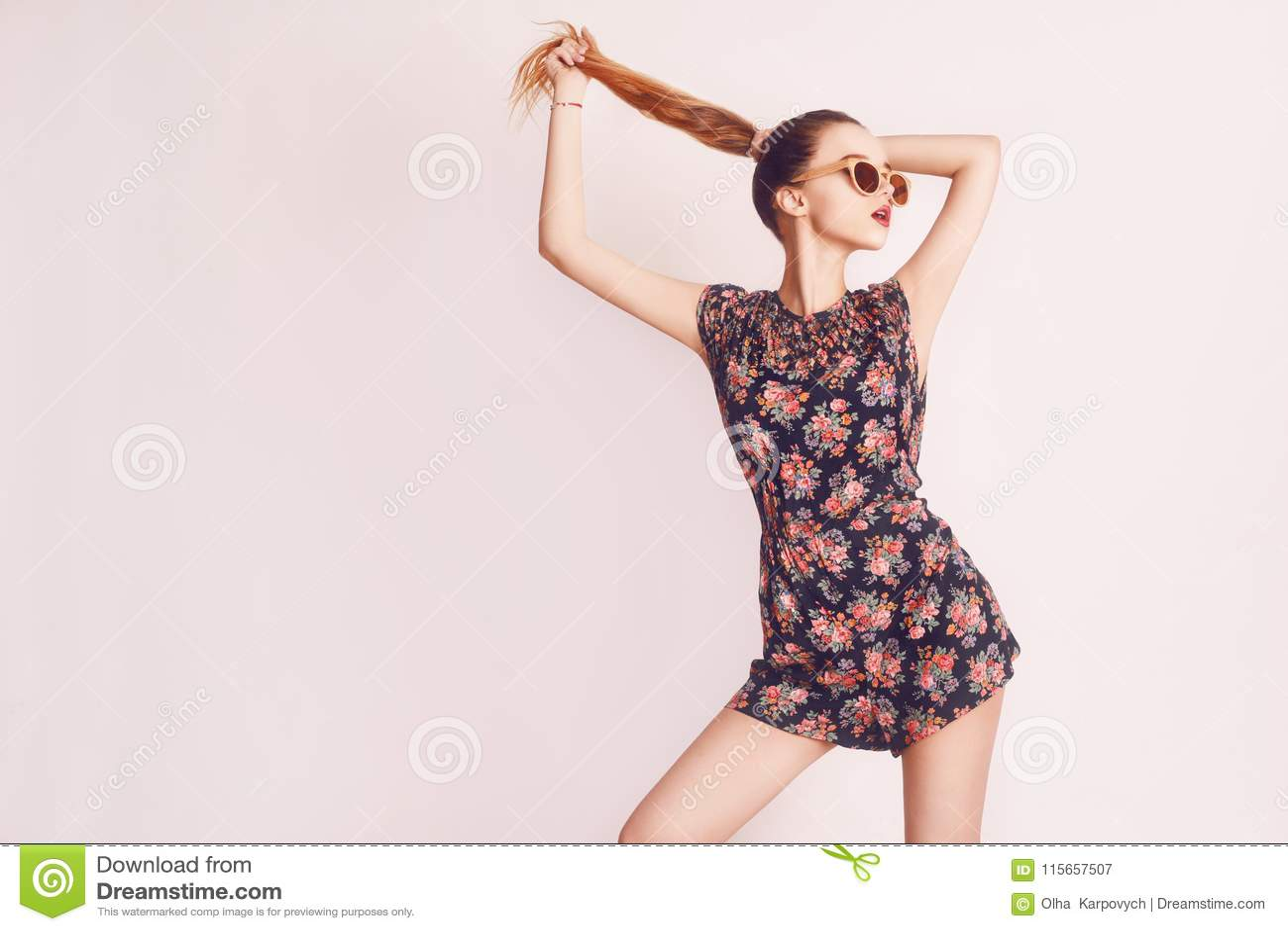 Stylish beauty model girl wearing dark wooden sunglasses and dress. Fashion beautiful woman with long hair wearing sunglasses.