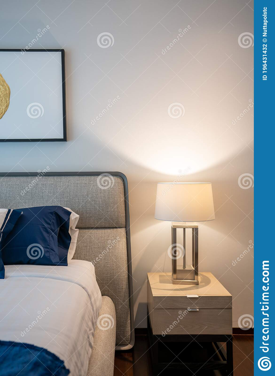 Stylish Bedroom Corner With Gray Fabric Headboard And Bed With Soft Pillows Setting With Navy Blue And White Painted Wall On The Stock Photo Image Of Metal Decor 196431432