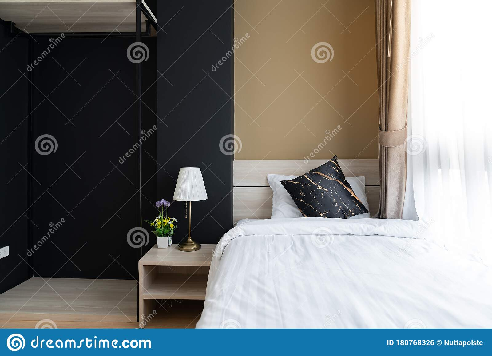 Stylish Bedroom Corner With Wooden Headboard And Bed With Soft Pillows Setting With Navy Blue And Yellow Painted Wall On The Stock Photo Image Of Decor Blanket 180768326