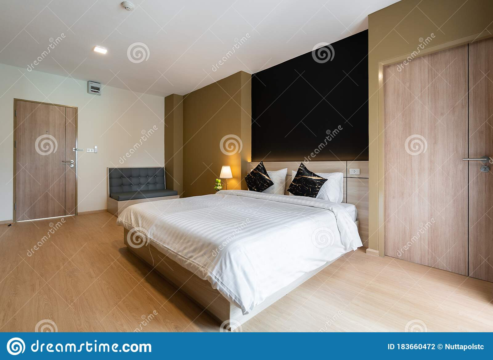 Stylish Bedroom Corner With Wooden Headboard And Bed With Soft Pillows Setting With Navy Blue And Yellow Painted Wall On The Stock Photo Image Of Circle Navy 183660472