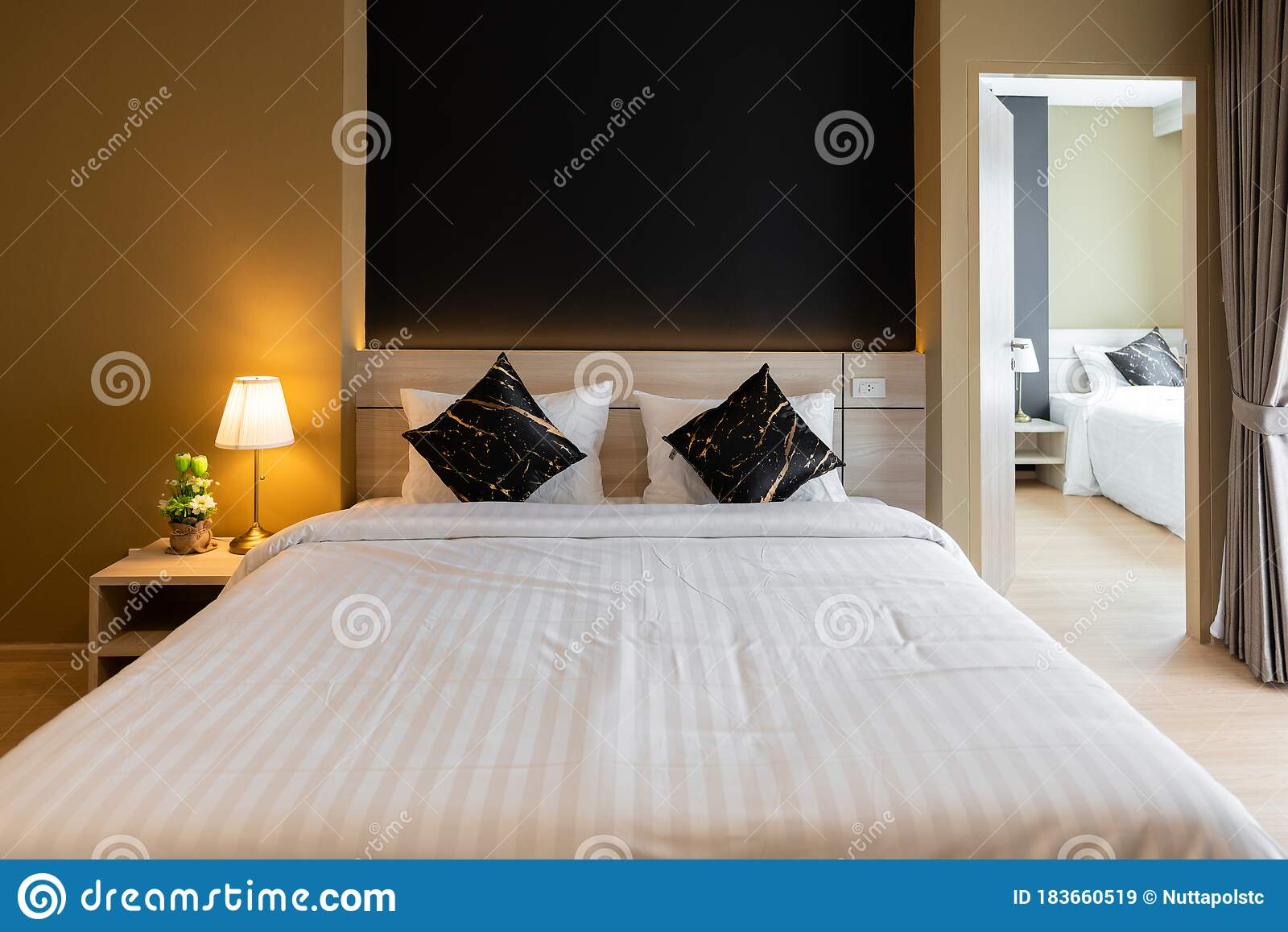 Stylish Bedroom Corner With Wooden Headboard And Bed With Soft Pillows Setting With Navy Blue And Yellow Painted Wall On The Stock Image Image Of Home Decoration 183660519