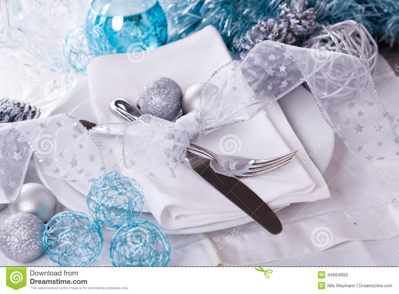 Stylish Blue And Silver Christmas Table Setting Stock